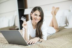 Young woman shopping from home Stock Photo