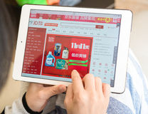 Young woman shopping through ipad on jd. Zhongshan,China-November 11, 2015:young woman shopping through ipad on jd on Chinese online shopping day on November 11 Stock Photography