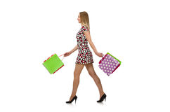 Young woman after shopping. Isolated on the white Royalty Free Stock Photos