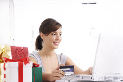 Young woman in shopping on-line. Happy shopping on-line of young woman with laptop on internet Stock Photo
