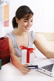 Young woman in shopping on-line. Happy shopping on-line of young woman with laptop on internet Royalty Free Stock Photos