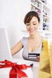 Young woman in shopping on-line. Happy shopping on-line of young woman with laptop on internet Stock Photos