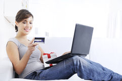 Young woman in shopping on-line. Happy shopping on-line of young woman with laptop on internet Stock Image