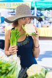 Farmers Market. Young woman shopping at the local Farmers market stock images