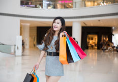 A young woman shopping in mall Royalty Free Stock Photo