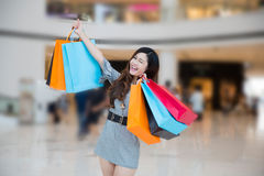 A young woman shopping in mall Stock Photo