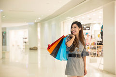 Young woman shopping in mall Stock Image