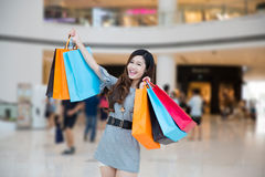 A young woman shopping in mall Stock Image