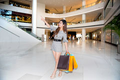 A young woman shopping in mall Stock Photography