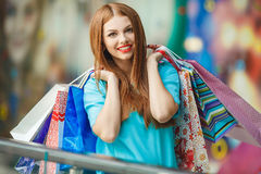 Young woman shopping in a mall. Fashion Shopping Girl Portrait. Beauty Woman with Shopping Bags in Shopping Mall. Shopper. Sales. Shopping Center Royalty Free Stock Photos