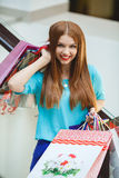 Young woman shopping in a mall Stock Images