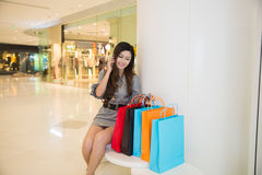 Young woman shopping in mall Royalty Free Stock Photo