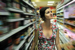 Young woman shopping in market Stock Photography