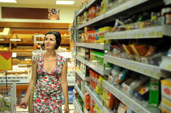 Young woman shopping in market Royalty Free Stock Images