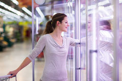 Young woman shopping for meat in a grocery store Stock Image