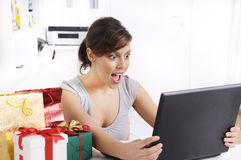 Young woman in shopping online. Happy shopping online of young woman with laptop on internet, concept of amazement Stock Photography