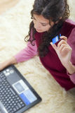 Young woman shopping online Royalty Free Stock Photography