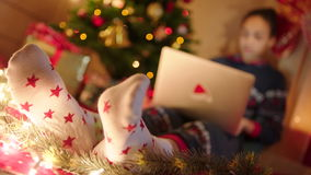 Young woman shopping online on Christmas Eve stock video footage