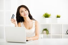 Young woman  shopping online with credit card Royalty Free Stock Photography