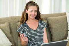 Young woman shopping online with a credit card Stock Photos