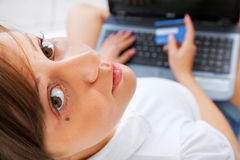 Young woman shopping online Stock Photos