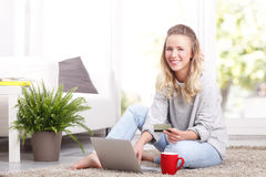 Young woman shopping online Royalty Free Stock Image