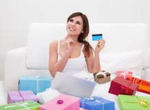 Young woman shopping online Royalty Free Stock Images