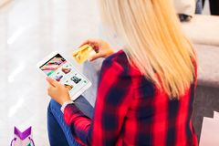 Young woman shopping online with tablet computer and credit card Royalty Free Stock Photos