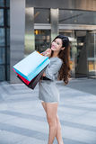 Young woman shopping outside the mall Royalty Free Stock Photos
