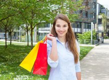 Young woman after shopping outside Stock Images