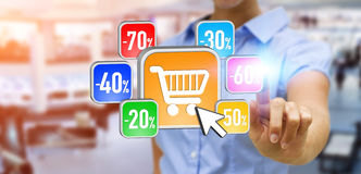 Young woman shopping during sales period. Businesswoman using modern application to shop online during sales Stock Photos