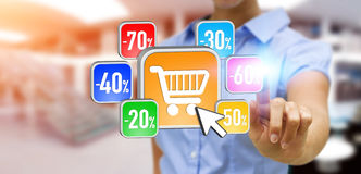 Young woman shopping during sales period. Businesswoman using modern application to shop online during sales Royalty Free Stock Photo