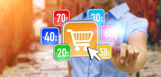 Young woman shopping during sales period. Businesswoman using modern application to shop online during sales Stock Photo