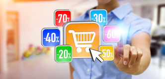 Young woman shopping during sales period. Businesswoman using modern application to shop online during sales Royalty Free Stock Photos