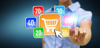 Young woman shopping during sales period. Businesswoman using modern application to shop online during sales Royalty Free Stock Photography