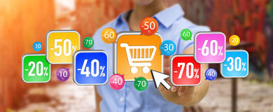 Young woman shopping during sales period. Businesswoman using modern application to shop online during sales Royalty Free Stock Image