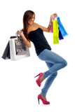 Young Woman on a Shopping Spree. Beautiful young woman with shopping bags isolated on white Royalty Free Stock Photos