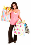 Young Woman on a Shopping Spree. A proud young woman is on a shopping spree royalty free stock image