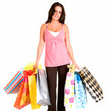 Young Woman on a Shopping Spree. A proud young woman is coming back from a shopping spree Stock Images