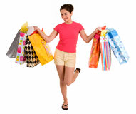 Young Woman on a Shopping Spree. A proud young woman is coming back from a shopping spree royalty free stock photo