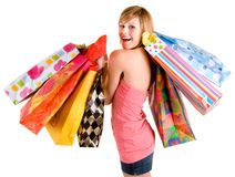 Young Woman on a Shopping Spree. A proud young woman is coming back from a shopping spree royalty free stock image