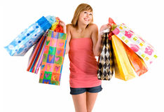 Young Woman on a Shopping Spree. A proud young woman is coming back from a shopping spree stock photos