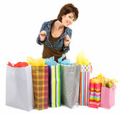 Young Woman on a Shopping Spree. A proud young woman is coming back from a shopping spree stock photography