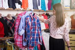 Young woman shopping in the store royalty free stock image