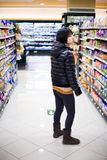 Young woman shopping in the supermarket Stock Images
