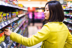 Young woman shopping in the supermarket Royalty Free Stock Image