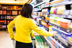 Young woman shopping in the supermarket.  Royalty Free Stock Photo