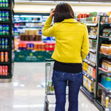 Young woman shopping in the supermarket Royalty Free Stock Images
