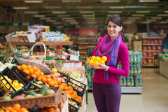 Young Woman Shopping In The Supermarket Royalty Free Stock Photo