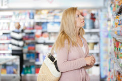 Young Woman Shopping At Supermarket Stock Photography